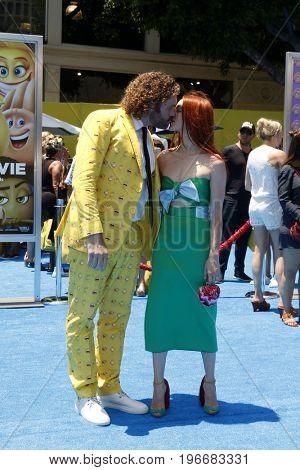 LOS ANGELES - JUL 23:  TJ Miller, Kate Gorney at