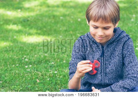 Child playing with spinner in city park