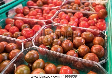 Organics Cherry Tomatoes In Plastic Boxes Sold At  Local City Market. Provence. France