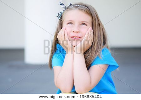 Adorable Girl Dreaming And Thinking About Future And Presents Outside