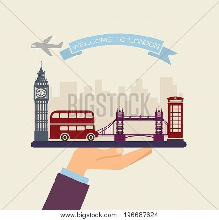 The hand holds the sights of London on a tray. The plane and the words welcome to London on the ribbon