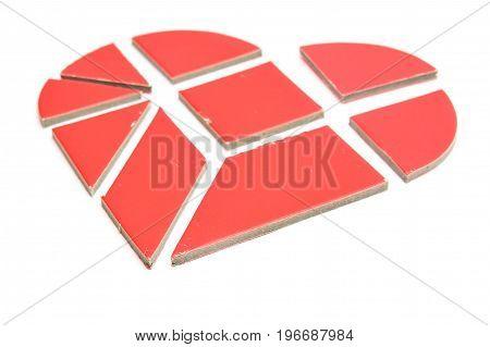 broken heart made of tangram game pieces