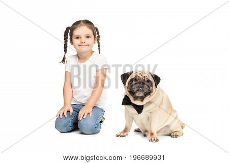 Little Happy Adorable Girl Sitting With Pug Dog In Bow Tie, Isolated On White