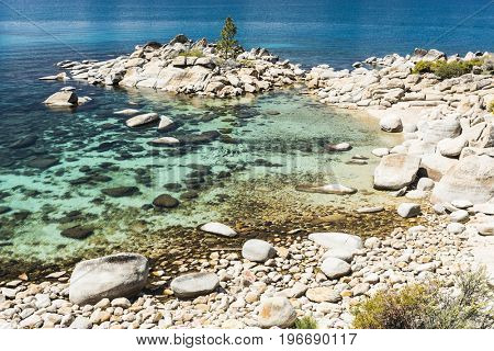 Beautiful boulders and crystal clear water of the lake Tahoe. Hidden Beach, Lake Tahoe - Nevada, USA