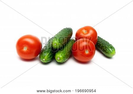 Ripe tomatoes and cucumbers isolated on white background. Horizontal photo.