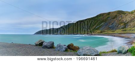 Panoramic image of Te Kopahou Reserve is located at Owhiro Bay where people can enjoy walking cycling and also driving 4WD vehicles along the coast Wellington North Island of New Zealand