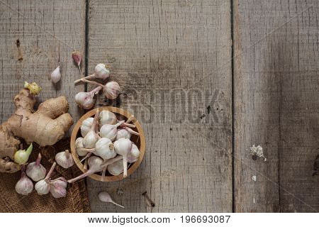 Garlic and ginger on old wooden floor.