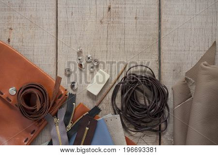 Leather and accessories on the old wooden floor.