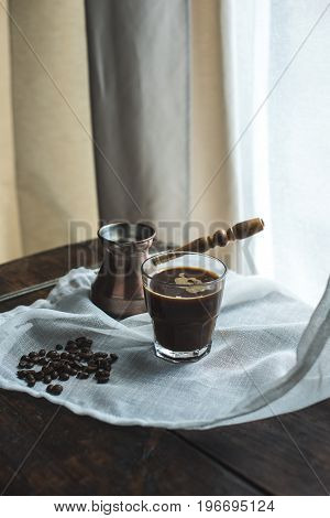 Turkish Coffee Pot With Glass Of Coffee On White Cloth With Coffee Beans