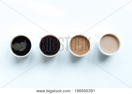 Close-up View Of Different Kinds Of Coffee In Row Isolated On White