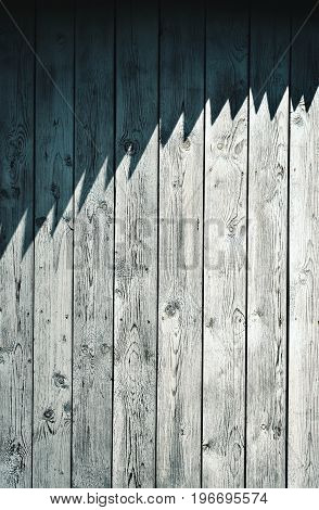 abstract background or texture Jagged shade on wooden cladding
