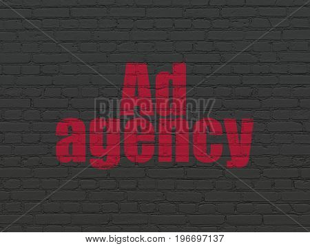 Advertising concept: Painted red text Ad Agency on Black Brick wall background