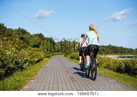 Two women riding bicycles