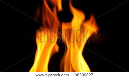 Fire Blazing While Cooking On Black Color Background.