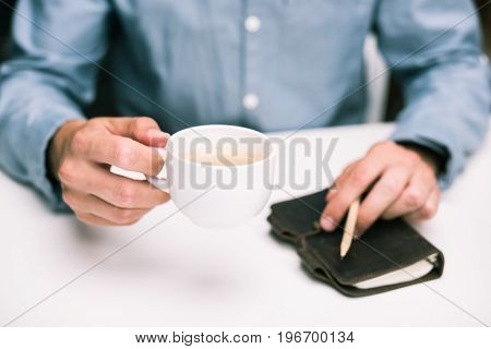 Cropped View Of Male Hands With Coffee Cup And Diary