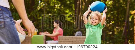 Boy Throwing Ball With Father