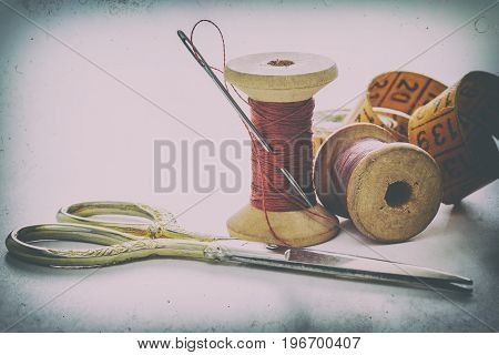 Sewing accessories for needlework and sewing scissors needles thread on white background creative image hobby retro style