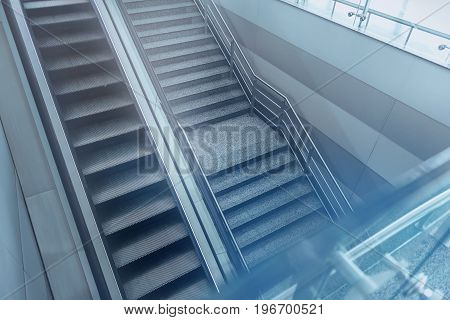 Useful machine. Top view of moving staircase and steps with no people are in international airport. Helpful facility for support transportation in modern building