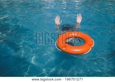 Female and lifebelt in water. Drowning help assistance concepts.