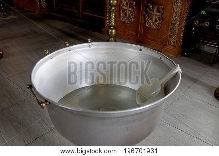 The baptism of a child in the Orthodox Church. Chan for ablution