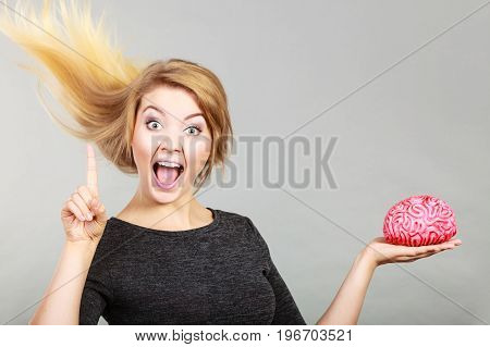 Happy Woman Holding Brain Having Idea