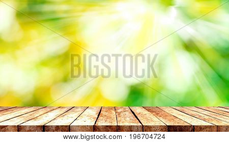 Wooden tabletop with fresh nature blurred background use for products or something display