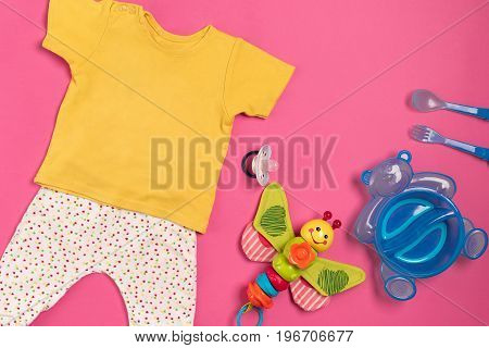 Baby clothes and accessories on pink background. Top view. Copy space. Still life. Flat lay