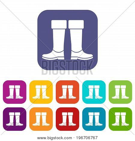 Rubber boots icons set vector illustration in flat style in colors red, blue, green, and other