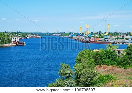 View of the cargo river harbor in early morning at beginning of summer
