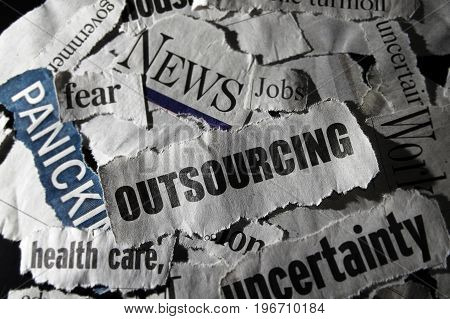 Outsourcing newspaper headline with related negative news clippings