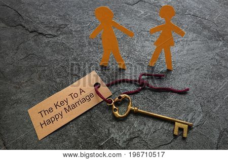 Paper couple with Key to Happy Marriage