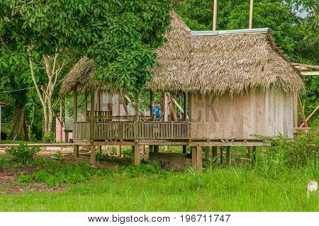 LAGO AGRIO, ECUADOR - NOVEMBER 17, 2016: Wooden house of siona community located inside of the amazon region in Cuyabeno Cuyabeno National Park, South America in Ecuador.