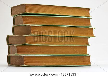 Six Old Books Stacked On White Background
