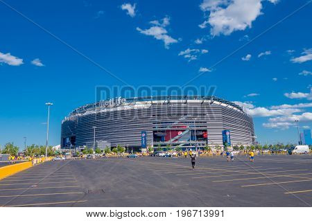NEW YORK, USA - NOVEMBER 22, 2016: Unidentified ecuadorian fans walking to enter to Metlife Stadium to see the football game in New York Usa.