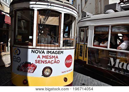 Lisbon Street Scene With Old Trams