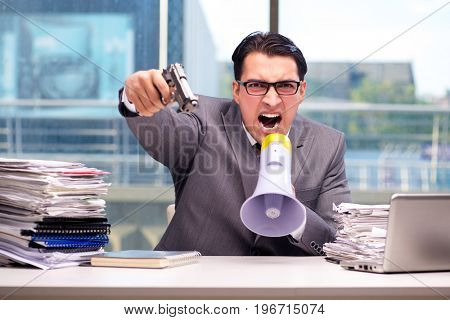 Angry businessman with gun in the office