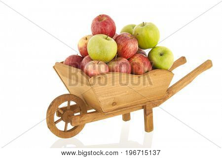 Wheel barrow with red and green apples isolated over white background