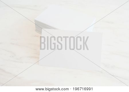 Mockup of blank business cards stack on marble table background. Template for ID. For design presentations and portfolios.