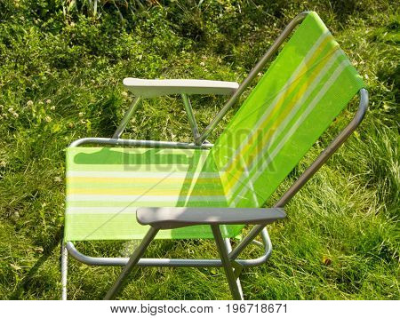 Folding Chair For Camping On Green Grass