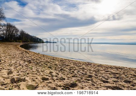 Shore of Lipno Lake with beach in autumn in Czech Republic. Nice view of beach and forest in background.