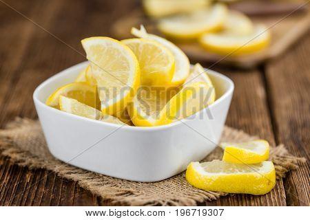 Lemon (sliced) On Wooden Background (selective Focus)