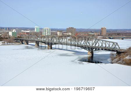 Alexandra Bridge across Ottawa River in winter, Gatineau and Ottawa, Ontario, Canada.
