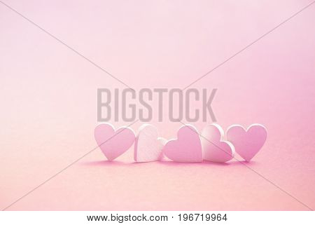 Valentine's Day greeting card. Group of five pink hearts. 3d illustration.