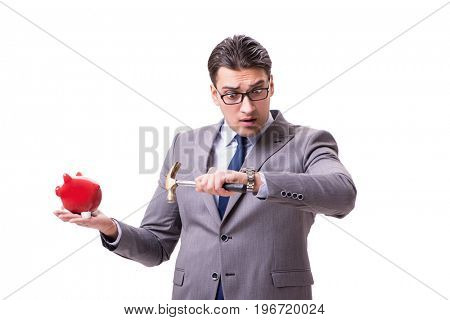Businessman breaking piggybank isolated white background