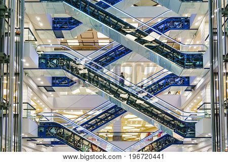 Escalators at the modern shopping mall, steel, glass
