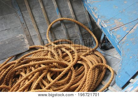 A rope piled on the deck of an historic boat in Sleeping Bear Dunes National Lakeshore, Michigan