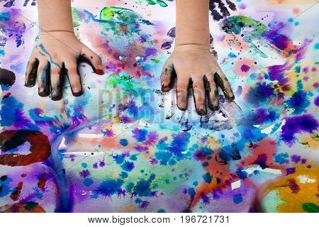 little girl playing with colors - detail of hands