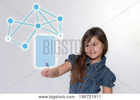 Long hair smiling little girl is touching a blank transparent rectangle with a social network symbol above it. All is on the light gray background.