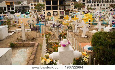 QUITO, ECUADOR- MAY 23, 2017: View of cemetery San Antonio de Pichincha, showing typical catholic graves with large gravestones.