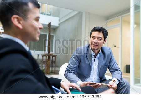 Business people discuss together